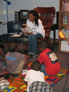 Dana Taylor from MIX 105.1 reading to children